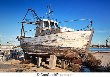 Abandoned boat wreck on the beach