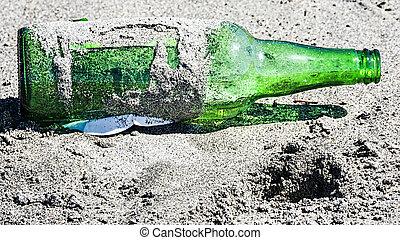 Abandoned bottle on the beach