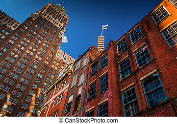 Abandoned brick building and highrise in Baltimore, Maryland.