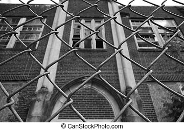 Abandoned Building - Chain link fence in front of old...