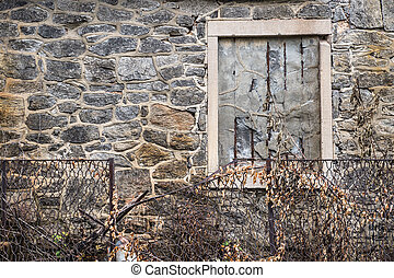 Abandoned building stone wall