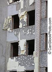 Abandoned building with broken windows