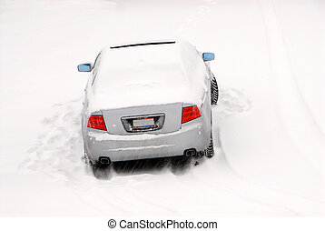 Abandoned Car in the Snow - A car is left abandoned in a...