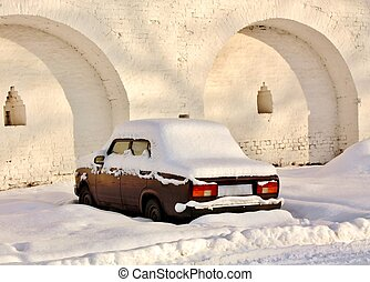 Abandoned car in winter