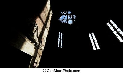 abandoned church with sun rays and grey stone