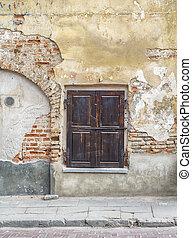 abandoned cracked brick wall