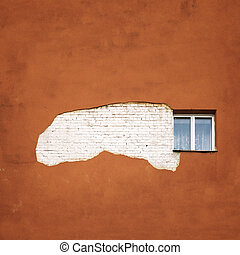 abandoned cracked brick wall with a window
