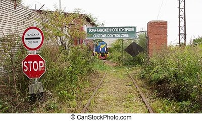 Abandoned depot with vintage railway carriage and customs...
