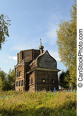 Abandoned destroyed wooden church in northern russian village