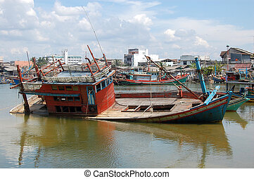 Abandoned drowned timber ship at port