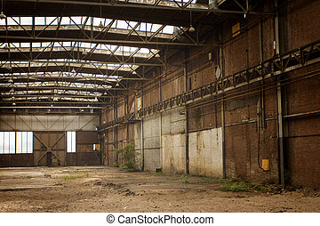 Abandoned empty old factory workshop interior