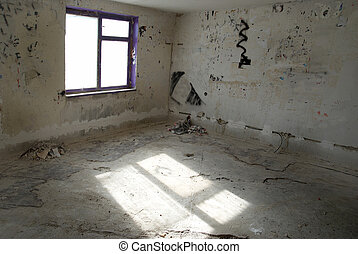 Abandoned empty room with window and light from it
