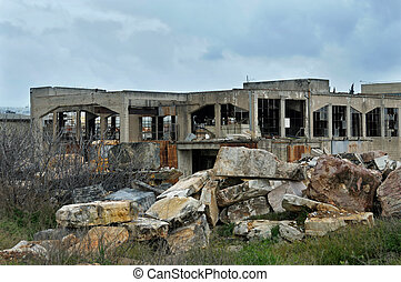 abandoned factory exterior and cloudy sky