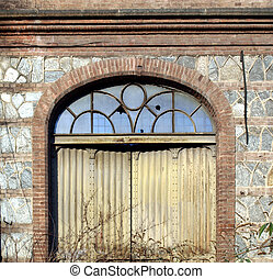 Abandoned factory - Industrial door in an abandoned factory ...