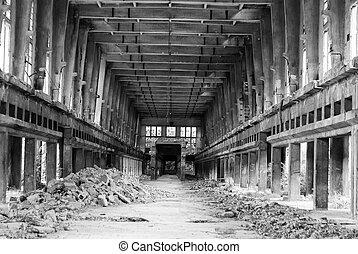 Abandoned factory room, with broken windows.