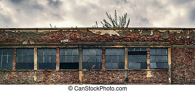 abandoned factory warehouse with broken windows