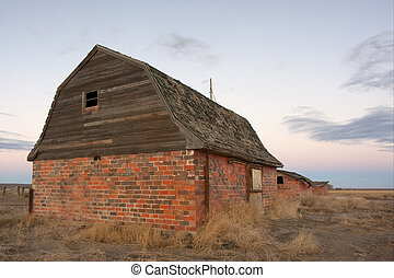 abandoned farm buildings in prairie