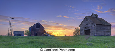 Abandoned Farmhouse and Barn At Sunset