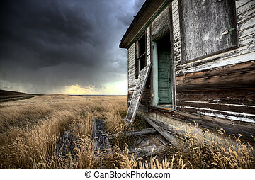 Abandoned Farmhouse Saskatchewan Canada sunset and prairie...