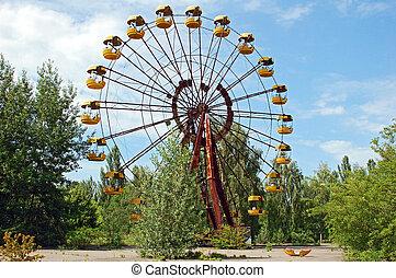 Abandoned ferris wheel in amusement park in Pripyat,...