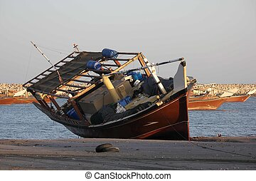 Abandoned fishing boat on the beach - Image taken in the ...