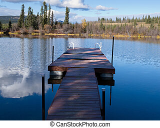 Abandoned floating dock for swimming in lake