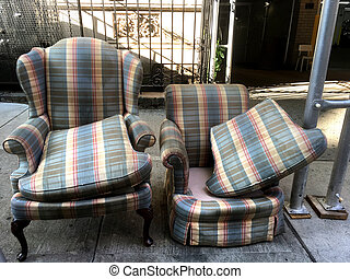 Abandoned furniture by curbside