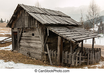 abandoned historic old wooden water mill house