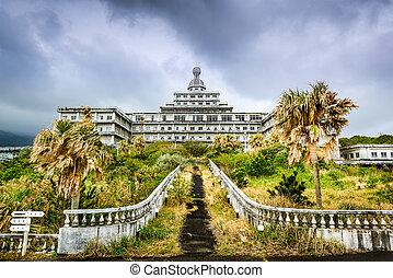 Abandoned Hotel - Abandoned hotel building ruins on...