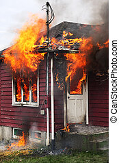 Abandoned House in Flames - Abandoned house burning, with...