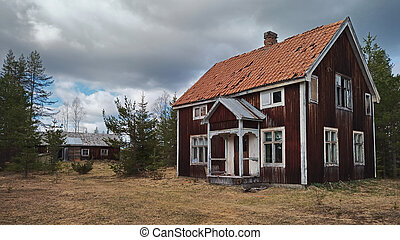 Abandoned house in northern Sweden with weathered facade.