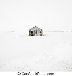 Abandoned house in winter.