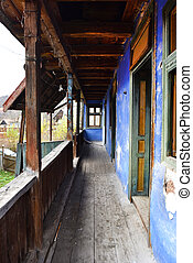 Abandoned house with a wooden porch