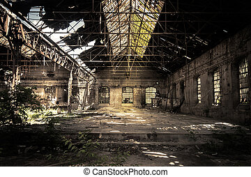 Abandoned industrial interior with bright light