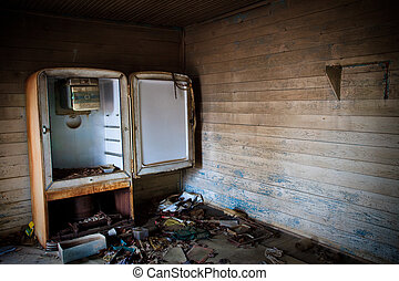 Abandoned Kitchen - The family is long gone but the sense...