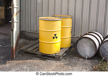 abandoned nuclear waste - Yellow barrels with radioactive...