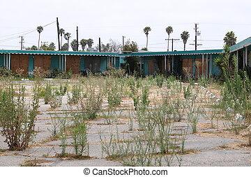 Abandoned - Old abandoned western style hotel motel.