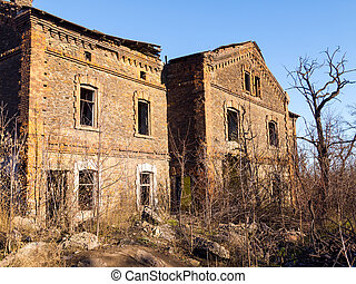 Old abandoned brick apartment building built in the early XX century.