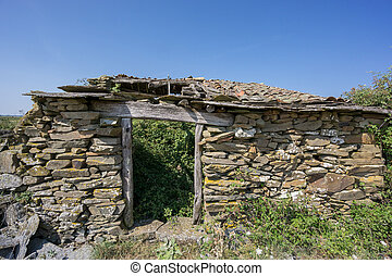 Abandoned old house made with stones, front view