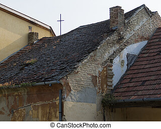 Abandoned old house with missing roof tiles