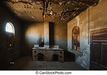 abandoned old kitchen in ruined partially collapsed building