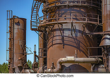 Abandoned old machines and storage units in a gas industry at gas works park Seattle