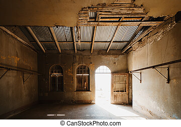 abandoned old room in ruined partially collapsed building