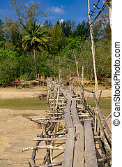abandoned old wooden bridge over the river