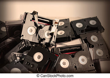 Abandoned pile of old useless mini DV