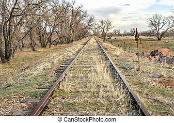 abandoned railroad tracks in Colorado prairie