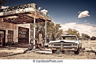 Abandoned restaraunt and old style car near gas station on the famous route 66 in New Mexico, USA. Vintage processing