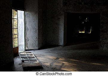 Abandoned room broken door and dramatic bright sunlight entering place