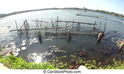 Abandoned rotting bamboo fish cage left untended on lake...