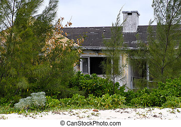abandoned run down house in trees - exterior of vacant run ...
